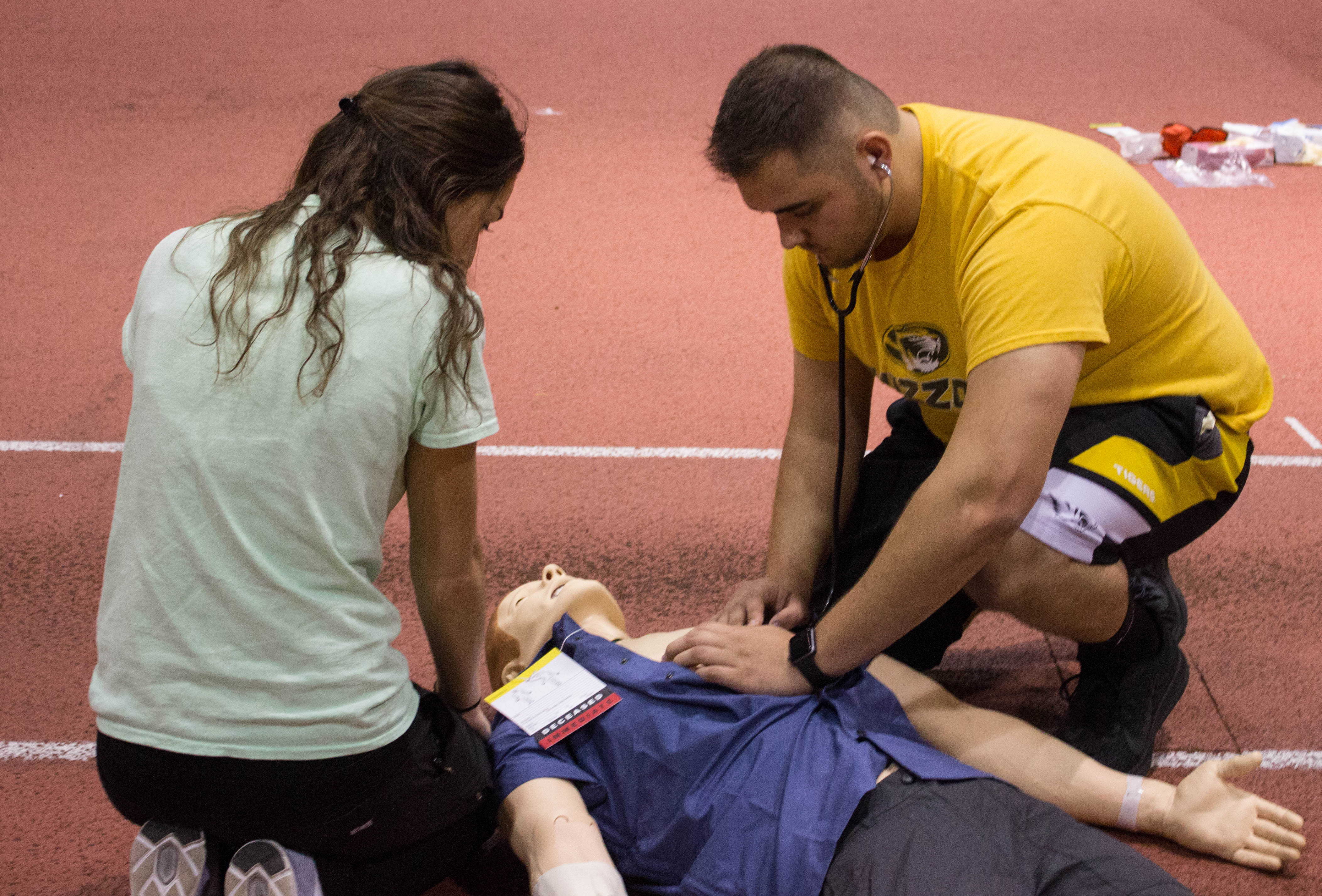 Respiratory Therapy student helps a hypothetical victim in a Mass Casualty simulation