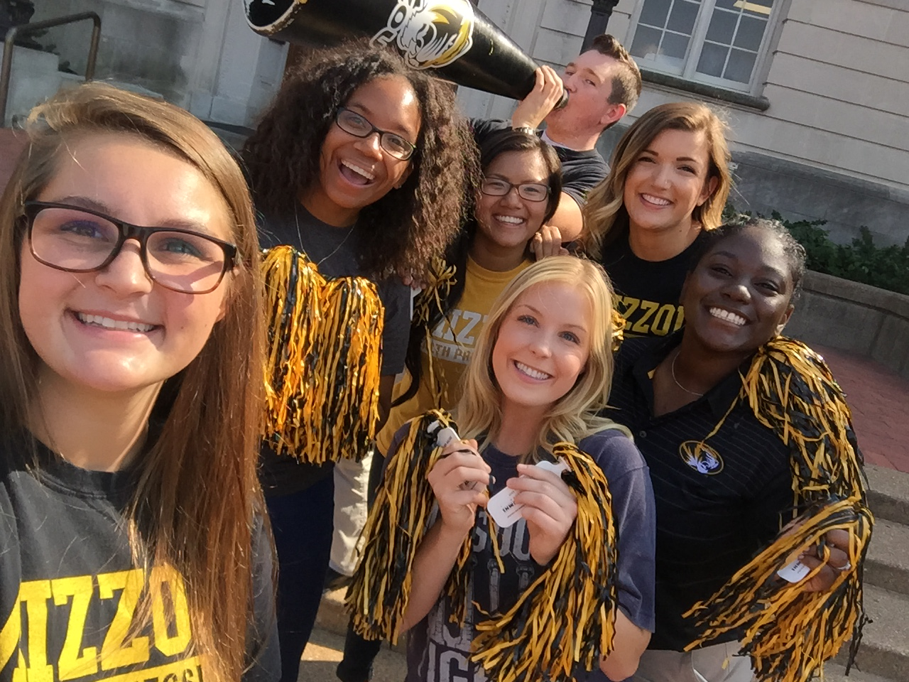 Students with Mizzou T-shirts and poms