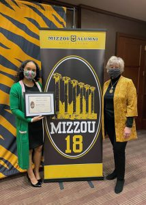 Kennedi Keyes and Cheri Ghan with Mizzou 18 banner
