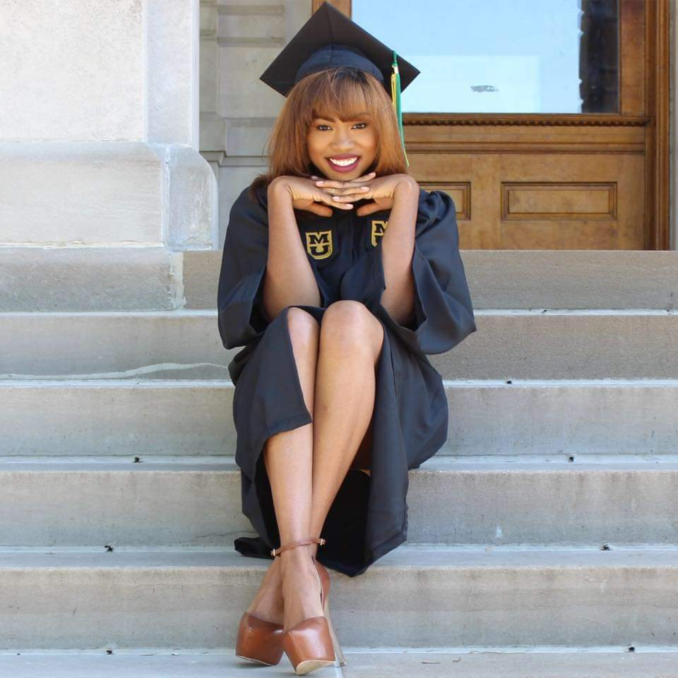 Anastasia on the steps of Jesse Hall wearing her cap and gown