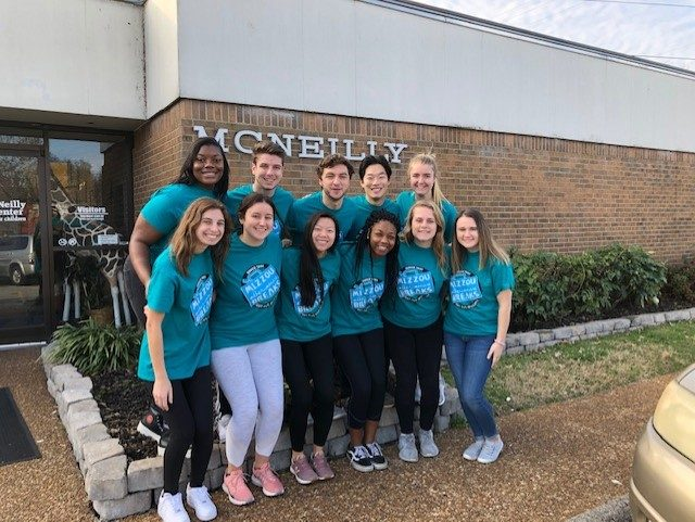 """Group of students in matching """"Mizzou Alternative Breaks"""" teal t-shirts"""