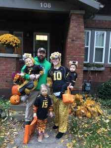 Claire Willard, her husband, and her two small children stand outside their home on Halloween all dressed up as Mizzou tigers
