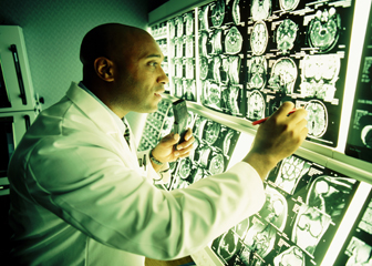 Doctor looking at MRI monitoring screen