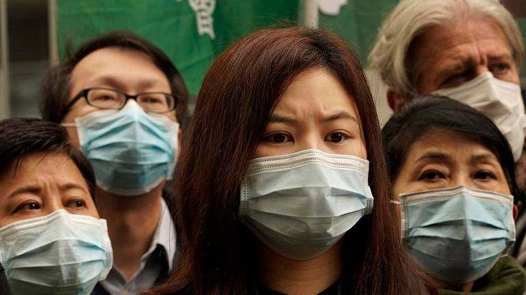 photo of women and men in medical masks, Vincent Yu The Associated Press