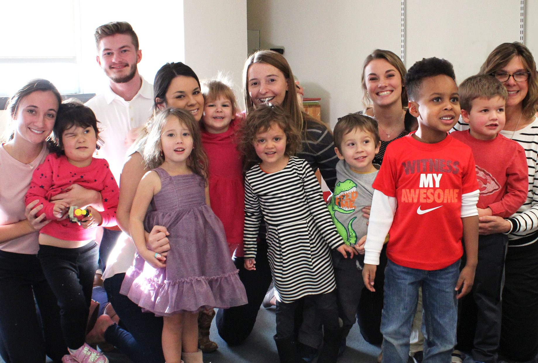 Greta Hull, SLHS Students, and Several Preschoolers pose for a photo on Greta Hull's last day
