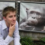 Seth Poynter mimics an image of a monkey resting his chin in his hand